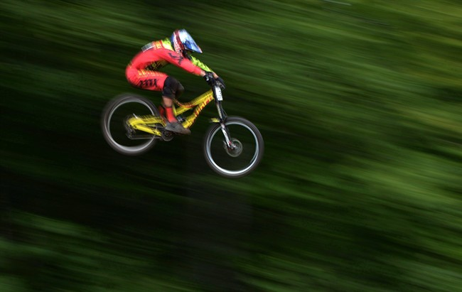 Canadian downhill mountain biker Steve Smith takes to the air during his qualification run during the UCI mountain bike world cup at Mont-Sainte-Anne in Beaupre, Que., in this July 31, 2015, file photo. Cycling Canada says the 26-year-old Smith, from Cassidy, B.C., died Tuesday as a result of a massive brain injury suffered from a motorcycle crash near his home in Nanaimo, B.C., last weekend. THE CANADIAN PRESS/Sean Kilpatrick