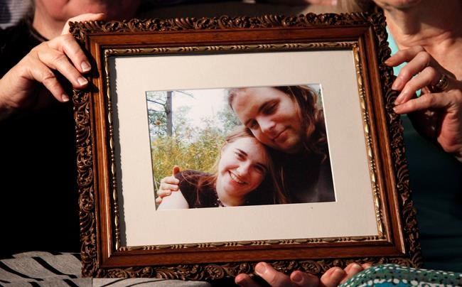 Mother's Linda Boyle, left and Lyn Coleman hold photo of their married children, Joshua Boyle and Caitlan Coleman, who were kidnapped by the Taliban in late 2012, Wednesday, June 4, 2014, in Stewartstown, Pa. - An American woman, her Canadian husband and their three young children have been released after years held captive by a network with ties to the Taliban. THE CANADIAN PRESS/AP-Bill Gorman