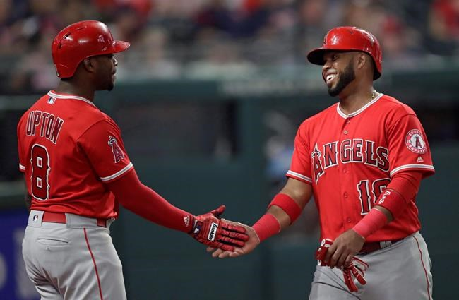 Los Angeles Angels' Luis Valbuena is congratulated by Justin Upton after Valbuena scored during the eighth inning against the Cleveland Indians in a baseball game in Cleveland on August 3, 2018. Former Major League Baseball players Luis Valbuena and Jose Castillo have been killed in a car crash in Venezuela. MLB tweeted late Thursday the 33-year-old Valbuena and 37-year-old Castillo died. Both were playing for Cardenales de Lara in the Venezuelan league. THE CANADIAN PRESS/AP, Tony Dejak