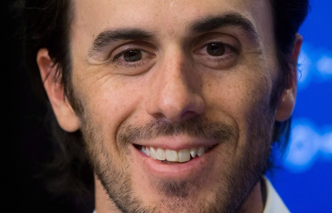 Vancouver Canucks' goalie Ryan Miller smiles during a news conference after he signed a three-year contract with the NHL hockey team in Vancouver, B.C., on Tuesday July 1, 2014. Miller is still surprised where he's ended up. After a long career in Buffalo and short stint in St. Louis, the veteran netminder is the undisputed No. 1 goalie heading into the season for the Vancouver Canucks. THE CANADIAN PRESS/Darryl Dyck