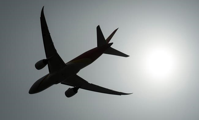 "A plane is silhouetted as it takes off from Vancouver International Airport in Richmond, B.C., Monday, May 13, 2019. Several Canadian airlines are scrubbing the phrase ""ladies and gentlemen"" from their in-flight announcements, replacing the gendered language with non-binary terminology as part of a broader shift toward corporate inclusivity. THE CANADIAN PRESS/Jonathan Hayward"