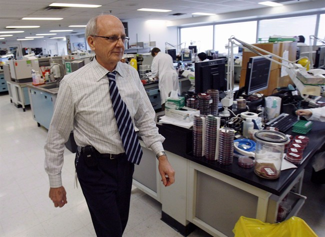 Infectious disease expert Dr. Donald Low walks through his laboratory in Toronto's Mount Sinai hospital, Tuesday, February 19, 2008. Dr. Low, one of the key figures in Canada's battle against SARS has died at 68. THE CANADIAN PRESS/J.P. Moczulski