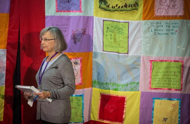 Chief commissioner Marion Buller listens before the start of hearings at the National Inquiry into Missing and Murdered Indigenous Women and Girls, in Smithers, B.C., on September 26, 2017. The long-awaited inquiry into missing and murdered Indigenous women has publicly released its findings including calls for health service providers to develop education programs for Indigenous children and youth on the issue of grooming for exploitation. THE CANADIAN PRESS/Darryl Dyck