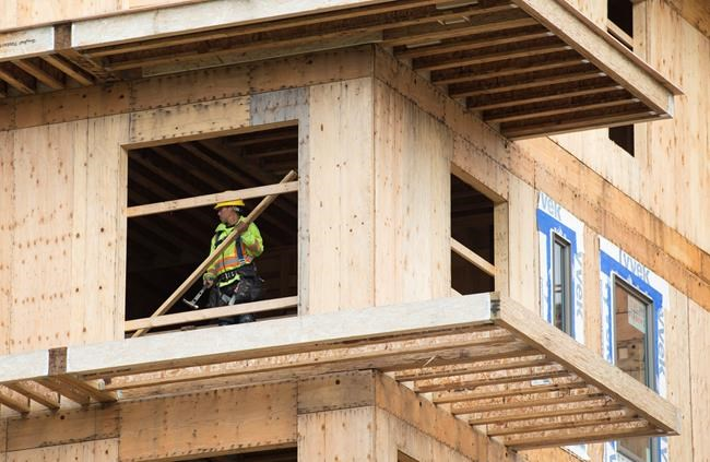 A worker is seen working on a construction project at UBC in Vancouver on April 23, 2019. Canada Mortgage and Housing Corp. says the annual pace of housing starts fell in October. The national housing agency says the seasonally adjusted annual rate of housing starts last month slowed to 201,973 units in October compared with 221,135 in September. THE CANADIAN PRESS/Jonathan Hayward