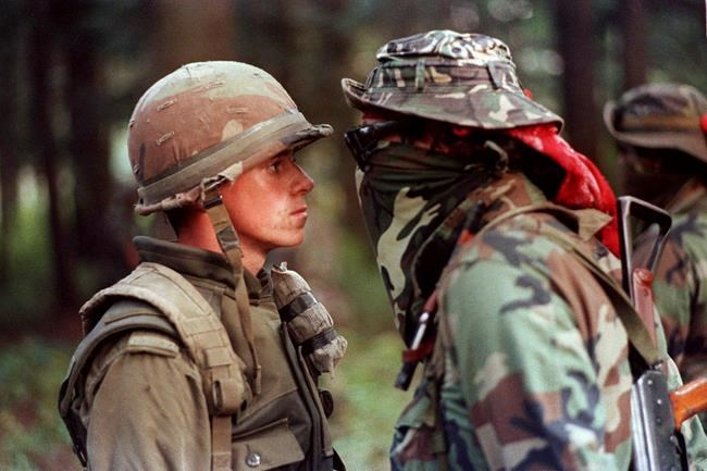 Canadian soldier Patrick Cloutier and Saskatchewan native Brad Laroque come face-to-face in a tense standoff at the Kahnesatake reserve in Oka, Que., Saturday September 1, 1990. The ghosts of Indigenous protests past have hovered over Prime Minister Justin Trudeau as his government struggles to bring a peaceful end to blockades that have disrupted traffic on rail lines and other major transportation routes across the country for more than two weeks. THE CANADIAN PRESS/ Shaney Komulainen