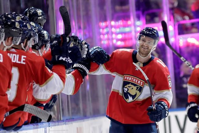 Florida Panthers left wing Jonathan Huberdeau is congratulated after scoring a goal during the second period of an NHL hockey game against the Montreal Canadiens, Sunday, Dec. 29, 2019, in Sunrise, Fla. THE CANADIAN PRESS/AP-Lynne Sladky