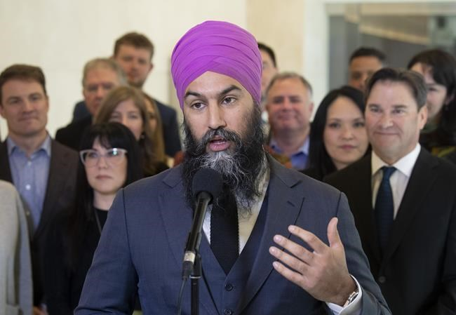 Surrounded by caucus members, NDP Leader Jagmeet Singh speaks with the media following the second day of caucus meetings in Ottawa on January 23, 2020. The NDP are asking for provincial support for the party's proposed universal pharmacare legislation in a letter to premiers, in the hopes of winning them over with a call for increased provincial health transfers. Party Leader Jagmeet Singh wrote to every Premier in the country Wednesday to outline the NDP's plan and ask for their buy in, which will be crucial if any universal pharmacare legislation is to move ahead. THE CANADIAN PRESS/Adrian Wyld