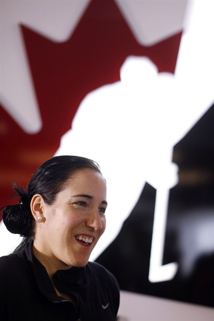 Canadian National Women's hockey player Caroline Ouellette, from Montreal, Que., speaks to a reporter a news conference in Calgary, Alta., Monday, May 27, 2013. Ouellette was named captain of Canada's women's team. THE CANADIAN PRESS/Jeff McIntosh