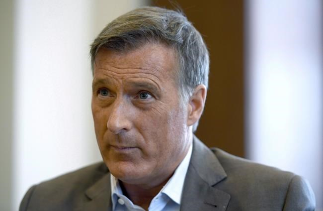 Conservative MP Maxime Bernier participates in an interview with The Canadian Press in his office on Parliament Hill in Ottawa on Wednesday, Aug. 1, 2018. Maverick Conservative MP and former leadership hopeful Maxime Bernier has called a news conference in Ottawa just as his caucus colleagues are kicking off a three-day gathering in Halifax. THE CANADIAN PRESS/Justin Tang
