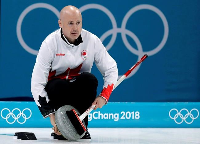 Canada's skip Kevin Koe uses his broom to clean the stone during the men's curling match against Switzerland at the 2018 Winter Olympics in Gangneung, South Korea on Feb. 23, 2018. Into an already crowded curling calendar comes the World Cup. But for Kevin Koe, the timing is right, the money is good and his new lineup needs reps. So a few short months after wearing the Maple Leaf at the Winter Olympics, Koe dons it again for the first leg of the World Curling Federation's newest property. THE CANADIAN PRESS/AP, Aaron Favila