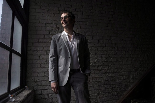 Atom Egoyan stops for a photo in Toronto on May 7, 2014. THE CANADIAN PRESS/Chris Young