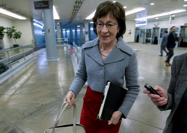 "Sen. Susan Collins, R-Maine, walks to the senate floor, Thursday, Feb. 8, 2018, at Capitol Hill in Washington. A Republican senator is trying to ease tensions in Canada's ongoing trade battles with the United States, turning to Twitter on the weekend to call attention to a Maine paper mill that is ""truly intertwined"" with its cross-border neighbours. THE CANADIAN PRESS/AP, Jose Luis Magana"