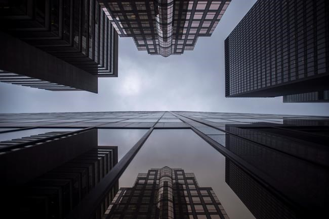 Bank buildings are photographed in Toronto's financial district on June 27, 2018. A federal banking regulator says Canada's largest banks will be required by April 30 to increase the amount of capital they hold to protect against vulnerabilities. THE CANADIAN PRESS/ Tijana Martin