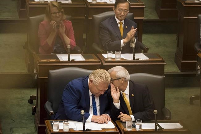 Ontario Premier Doug Ford's decision to cancel rebates for electric vehicles in the province is expected to have a knock-on effect on sales. Premier Ford leans in to listen to Finance Minister Victor Fedeli during the first Session of the 42nd Parliament of Ontario at Queen's Park in Toronto on Thursday, July 12, 2018. THE CANADIAN PRESS/ Tijana Martin