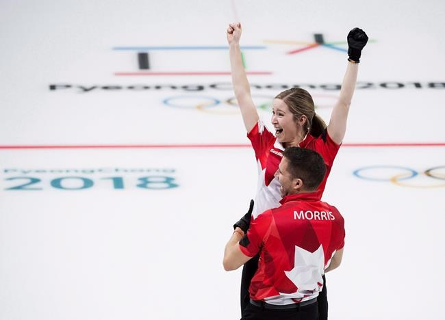 Canadians Kaitlyn Lawes and John Morris react after defeating Switzerland to win gold during mixed doubles curling action at the 2018 Olympic Winter Games in Gangneung, South Korea on February 13, 2018. John Morris is all in on mixed doubles curling. Winning the first Olympic gold medal in it will do that to you. He hasn't completely shut the door on a return to a men's team in the future, but Morris currently feels more passionate about curling's newest discipline. THE CANADIAN PRESS/Nathan Denette
