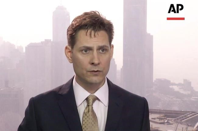 In this image made from a video taken on March 28, 2018, North East Asia senior adviser Michael Kovrig speaks during an interview in Hong Kong. Global Affairs Canada says its consular officials in China were allowed a visit with detained former diplomat Michael Kovrig today. It is the fifth time Kovrig is receiving a consular visit since he was detained by Chinese authorities in early December but the first since he and fellow detainee Michael Spavor were charged with stealing state secrets two weeks ago. THE CANADIAN PRESS/AP Photo