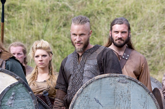 """This image released by History shows Katheryn Winnick, as Lagertha, left, Travis Fimmel, as Ragnar, center, and Clive Standen as Rollo in a scene from """"Vikings."""" THE CANADIAN PRESS/AP-ho-History, Jonathan Hession"""