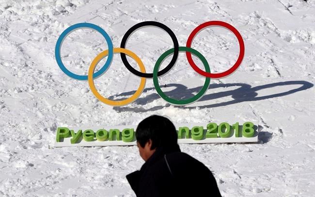 A man walks by the Olympic rings with a sign of 2018 Pyeongchang Olympic and Paralympic Winter Games in Pyeongchang, South Korea on Feb. 3, 2017. Pyeongchang, South Korea, the host of next month's Winter Games, is 14 hours ahead of Eastern Time, which will require Canadian viewers to stay up late or get up early to catch some of their favourite events live on CBC. THE CANADIAN PRESS/AP, Lee Jin-man
