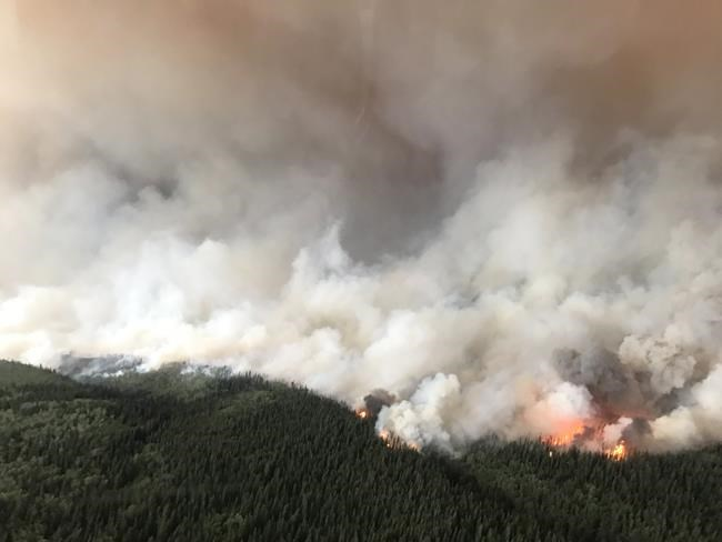 The South Stikine River fire burns in an Aug.6, 2018 handout photo provided by the BC Wildfire Service. The BC Wildfire Service says its priority is to protect homes and properties in a northwestern B.C. community already hammered by a wildfire. THE CANADIAN PRESS/HO-BC Wildfire Service MANDATORY CREDIT