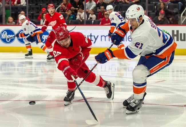 Detroit Red Wings forward Taro Hirose (67) challenges a pass from New York Islanders defenseman Luca Sbisa (21), of Italy, in the second period of a preseason NHL hockey game in Detroit on September 20, 2019. The Winnipeg Jets scooped up some blue-line help Wednesday, claiming defenceman Luca Sbisa off waivers. The 29-year-old signed a contract with the Anaheim Ducks on Tuesday, but needed to pass through the waiver wire before joining the team. THE CANADIAN PRESS/AP, Tony Ding