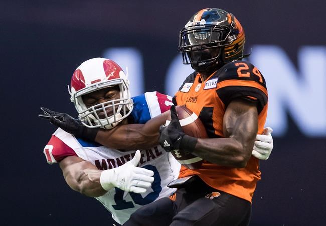 B.C. Lions' Jeremiah Johnson, right, is tackled by Montreal Alouettes' Henoc Muamba during the first half of a CFL football game in Vancouver, on June 16, 2018. He's one of the CFL's top defensive players and among its leading tacklers but Henoc Muamba didn't always enjoy the physical aspect of the game. In fact, early in his football career the Montreal Alouettes linebacker went to great lengths to avoid being hit. THE CANADIAN PRESS/Darryl Dyck