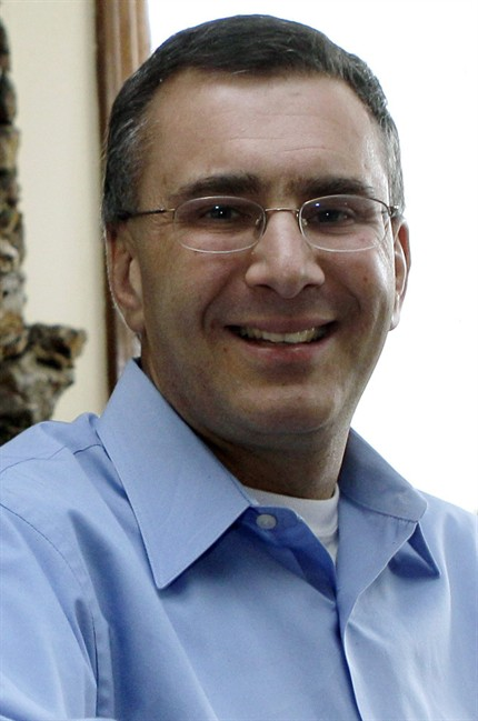Jonathan Gruber, a Mass. Institute of Technology economist and advisor to President Obama, poses in his home in Lexington, Mass., Tuesday, Feb. 8, 2011. THE CANADIAN PRESS/AP/Charles Krupa