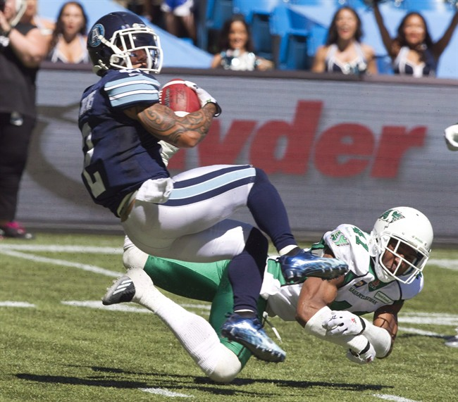 Saskatchewan Roughriders Tyron Brackenridge misses the tackle on Toronto Argonauts Chad Owens during first half action in their CFL game in Toronto Saturday July 5, 2014. The Roughriders have signed safety Brackenridge to an extension. THE CANADIAN PRESS/Fred Thornhill