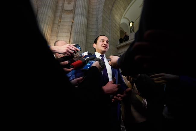 Manitoba NDP Leader Wab Kinew speaks to media following the delivery of Manitoba's 2019 budget, at the Legislative Building in Winnipeg, on March 7, 2019. Manitoba New Democrats are promising to raise income taxes on high earners, boost the minimum wage and implement modest health care spending increases if they win the Sept. 10 provincial election. THE CANADIAN PRESS/David Lipnowski