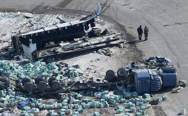 Mandatory training for commercial truck drivers in Saskatchewan is to begin Friday. The wreckage of a fatal crash outside of Tisdale, Sask., is seen Saturday, April, 7, 2018. The change was announced in December, eight months after a deadly crash between a semi and a bus carrying the Humboldt Broncos junior hockey team. THE CANADIAN PRESS/Jonathan Hayward
