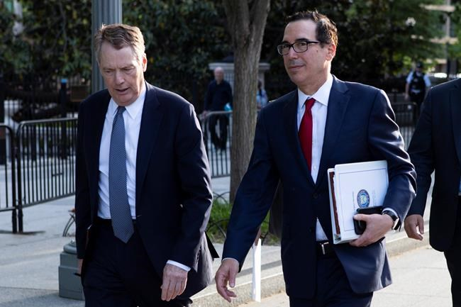 United States Trade Representative Robert Lighthizer, left, and Treasury Secretary Steven Mnuchin walk on Pennsylvania Avenue back to the White House on Thursday, May 9, 2019, in Washington. A top Trump administration cabinet member says the end of punishing steel and aluminium tariffs on Canada and Mexico is close at hand. THE CANADIAN PRESS/AP, Jon Elswick