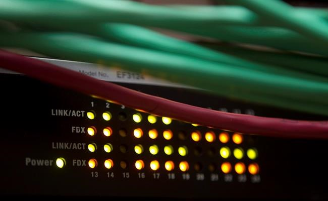 Lights on an internet switch are lit up as with users in an office in Ottawa, on February 10, 2011. TransUnion Canada says the personal information of about 37,000 Canadian customers may have been compromised between June and July. THE CANADIAN PRESS/Adrian Wyld