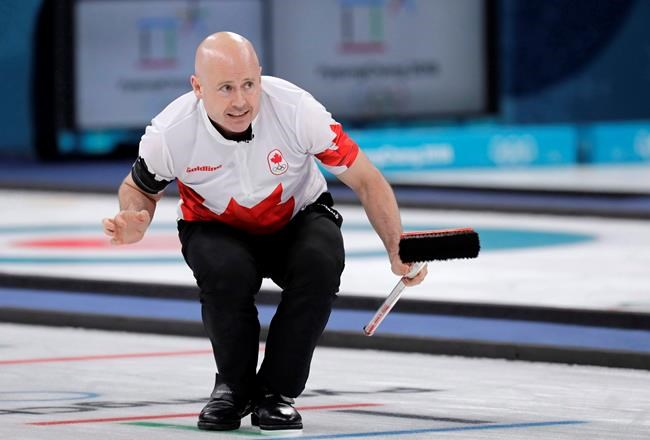 Canada's skip Kevin Koe gestures during the men's curling match against Switzerland at the 2018 Winter Olympics in Gangneung, South Korea, Friday, Feb. 23, 2018. Koe is on a roll at the Canada Cup. The Calgary skip (4-1) won his fourth in a row on Friday morning with a 10-3 win over Edmonton's Brendan Bottcher (3-2). (AP Photo/Aaron Favila)