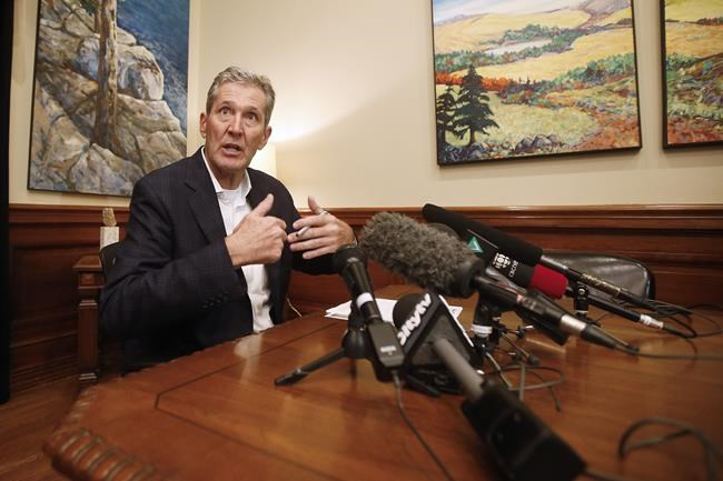 Manitoba Premier Brian Pallister speaks with media to announce his party's new mandate at the Manitoba Legislature after winning the provincial election in Winnipeg, Wednesday, September 11, 2019.  A year ago, Pallister tried to eliminate the election expenses rebate. (John Woods / The Canadian Press files)