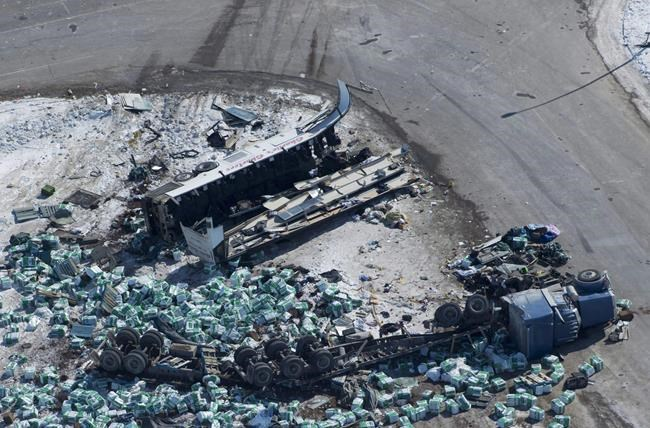 The wreckage of a fatal bus crash carrying members of the Humboldt Broncos hockey team outside of Tisdale, Sask., is seen on April, 7, 2018. THE CANADIAN PRESS/Jonathan Hayward