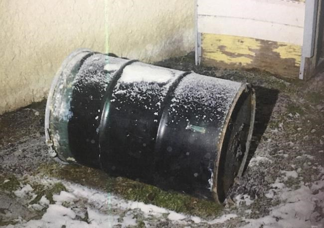 A barrel is seen in a Winnipeg yard in this undated handout photo provided by Manitoba Court of Queen's Bench. Perez Cleveland, 46, has pleaded not guilty in the death of 42-year-old Jennifer Barrett, whose body was found in a barrel behind their Winnipeg home in December 2016. THE CANADIAN PRESS/HO, Manitoba Court of Queen's Bench *MANDATORY CREDIT*