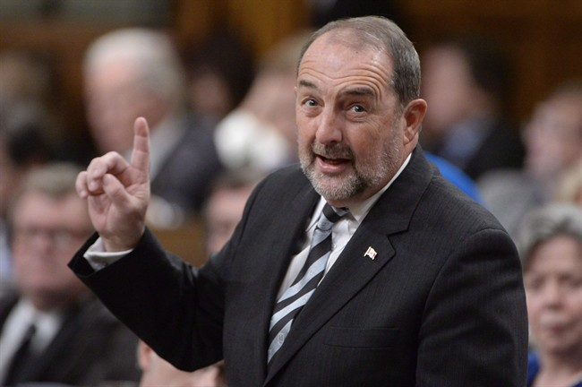 Infrastructure Minister Denis Lebel responds to a question during question period in the House of Commons on Parliament Hill in Ottawa on Tuesday, Feb. 3, 2015. Police in Quebec are investigating after envelopes containing white powder were sent to the riding offices of at least two federal ministers, including Lebel. THE CANADIAN PRESS/Adrian Wyld
