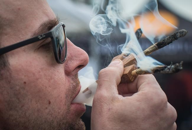 Once recreational use of marijuana is legalized, people who smoke pot in a provincial park or campsite in Manitoba will face a fine of $672. (Darryl Dyck / The Canadian Press)