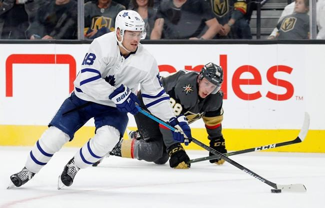 Toronto Maple Leafs left wing Andreas Johnsson skates around Vegas Golden Knights defenseman Nate Schmidt (88) during the third period of an NHL hockey game Tuesday, Nov. 19, 2019, in Las Vegas. Toronto Maple Leafs forward Andreas Johnsson has been placed on long-term injury reserve with a leg injury. Johnsson underwent a CT scan Thursday after suffering the injury on Wednesday against the Colorado Avalanche. THE CANADIAN PRESS/AP, John Locher