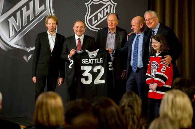 NHL commissioner Gary Bettman, center after the NHL Board of Governors announced Seattle as the league's 32nd franchise, Tuesday.