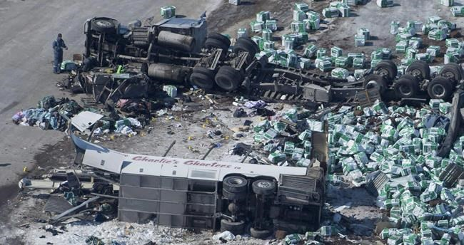 A lawsuit filed this week by the parents of one of the Humboldt Broncos players killed in a collision this past April has asked for a court order requiring all buses carrying sports teams to be equipped with seatbelts and other safety devices. The wreckage of a fatal crash outside of Tisdale, Sask., is seen Saturday, April, 7, 2018. THE CANADIAN PRESS/Jonathan Hayward