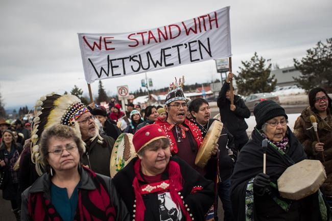 Hereditary Chief Ronnie West, centre, from the Lake Babine First Nation, sings and beats a drum during a solidarity march after Indigenous nations and supporters gathered for a meeting to show support for the Wet'suwet'en Nation, in Smithers, B.C., on January 16, 2019. More than 200 Canadian musicians and industry players are standing in solidarity with people from a northern B.C. First Nation as they protest the construction of a natural gas pipeline on traditional territories. THE CANADIAN PRESS/Darryl Dyck