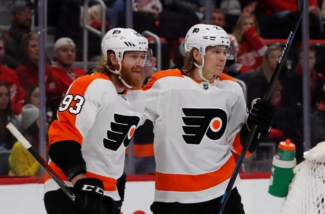 Philadelphia Flyers right wing Jakub Voracek (93) congratulates teammate left wing Oskar Lindblom after a goal during the first period of an NHL hockey game against the Detroit Red Wings, Sunday, Feb. 17, 2019, in Detroit. Voracek was psyched at the mere suggestion the Philadelphia Flyers might play an NHL game in his native Czech Republic. THE CANADIAN PRESS/APCarlos Osorio
