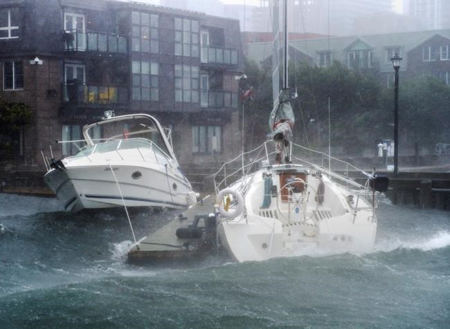 Pleasure boats take a beating along the waterfront in Halifax as hurricane Dorian approaches on Saturday, Sept. 7, 2019. A team at Memorial University says it recorded a 100-foot wave off the southwestern coast of Newfoundland during the tail end of post-tropical storm Dorian. THE CANADIAN PRESS/Andrew Vaughan