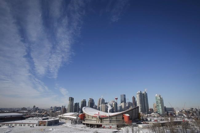 The deal to build a new arena downtown is official after definitive agreements were signed between the city, the Calgary Flames organization and Calgary Stampede. Steam rises from buildings near the Saddledome in Calgary, Alta., Wednesday, Feb. 8, 2017. THE CANADIAN PRESS/Jeff McIntosh