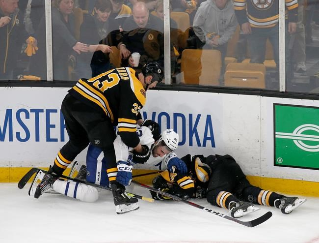 Boston Bruins defenseman Zdeno Chara (33) pulls Toronto Maple Leafs center Nazem Kadri (43) off teammate Jake DeBrusk (74) after Kadri hit DeBrusk into the boards during the third period of Game 2 of an NHL hockey first-round playoff series, Saturday, April 13, 2019, in Boston. he Toronto Maple Leafs will have to do without Nazem Kadri for the rest of their first-round playoff series with the Boston Bruins. THE CANADIAN PRESS/AP, Mary Schwalm
