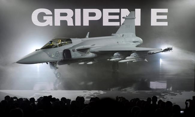 The new E version of the Swedish JAS 39 Gripen multi role fighter being rolled out at SAAB in Linkoping, Sweden, Wednesday, May 18, 2016. Swedish fighter-jet maker Saab says it has not decided whether it will participate in the $19-billion competition to replace the Canada's aging fleet of CF-18s. THE CANADIAN PRESS/AP-Anders Wiklund/TT SWEDEN OUT