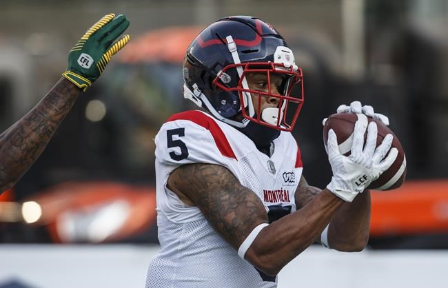 Montreal Alouettes' DeVier Posey (5) makes the catch for the touchdown against the Edmonton Eskimos during first half CFL action in Edmonton on Friday June 14, 2019. THE CANADIAN PRESS/Jason Franson.