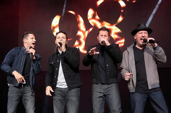"98 Degrees band members, from left, Jeff Timmons, Drew Lachey, Nick Lachey and Justin Jeffre perform at KTUphoria 2018 at Jones Beach Theater in Wantagh, N.Y., on June 16, 2018. Reunited boy band 98 Degrees will serenade the masses as part of the upcoming iHeartRadio MMVAs. The heart-throb foursome, known for their late 1990s hits ""I Do (Cherish You)"" and ""Because of You,"" are among the latest batch of performers announced for the broadcast on Aug. 26. THE CANADIAN PRESS/AP, Invision - Charles Sykes"