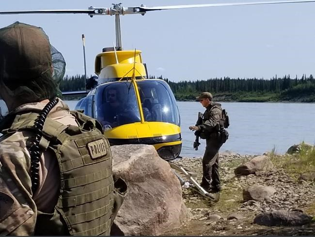 RCMP search an area near Gillam, Man. in this photo posted to their Twitter page on Tuesday, July 30, 2019. Officers are in the Gillam area to search for 18-year-old Bryer Schmegelsky and his 19-year-old friend Kam McLeod. The teens are charged with second-degree murder in the death of one man and are suspects in the fatal shootings of a young couple.THE CANADIAN PRESS/HO, Twitter, Manitoba RCMP, @rcmpmb *MANDATORY CREDIT*