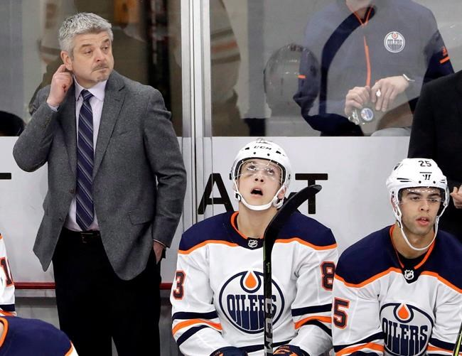 Edmonton Oilers head coach Todd McLellan, left, is the odds-on favourite to be fired first this season.